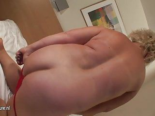 Overweight booty blond mother playing with her peculiar toy