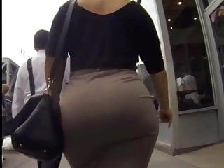Candid large butt walking in taut work suit
