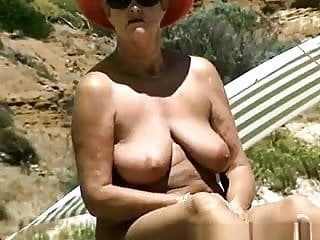Oiled lady on stripped beach