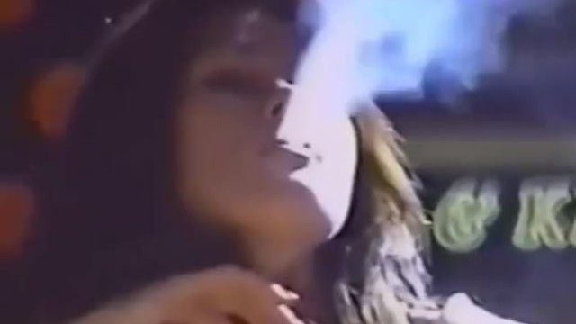 Unknown pretty woman smokin outside candid enormous exhales 1990s